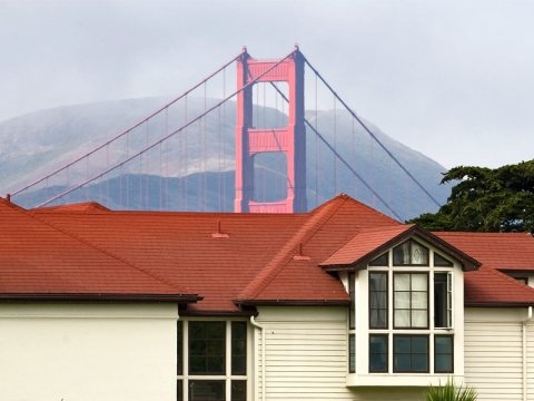 The Golden Gate Bridge looms behind the Presidio Fire Station