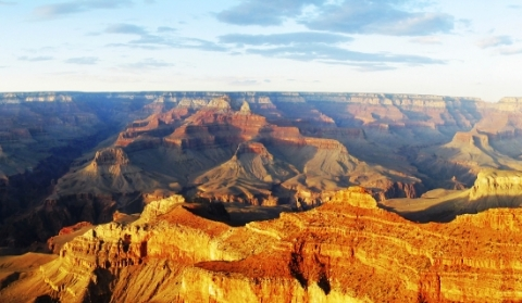 Image of sunny grand canyon with mountain peaks