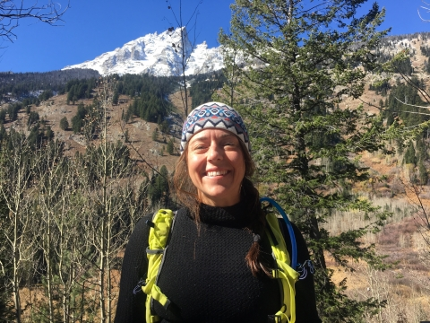 Ashley McEvoy in a hat, dressed for a hike in Grand Teton National Park