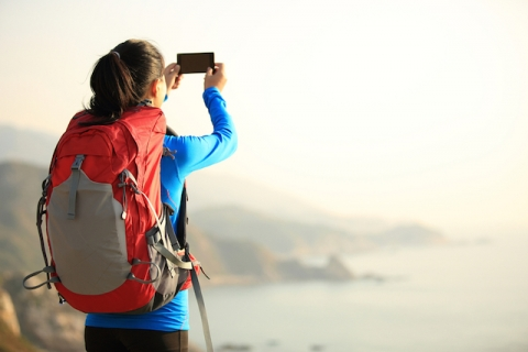 Hiker taking photo on phone