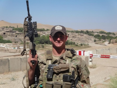 Military Serviceman holding gun while on duty