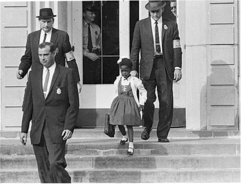 A photograph of young Ruby Bridges being escorted from school in 1960