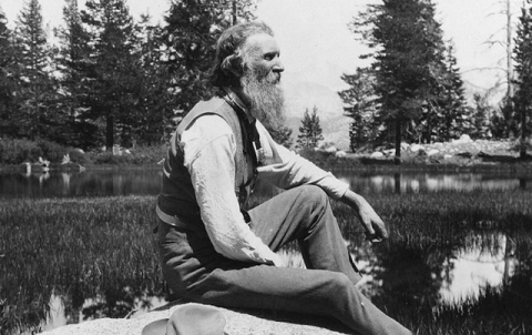 Black and white image of John Muir sitting outdoors