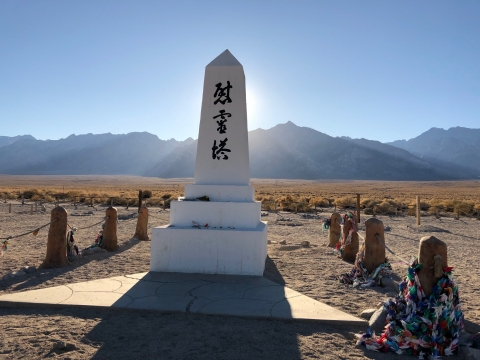 Memorial obelisk with a mountain range in the background at Manzanar National Historic Site