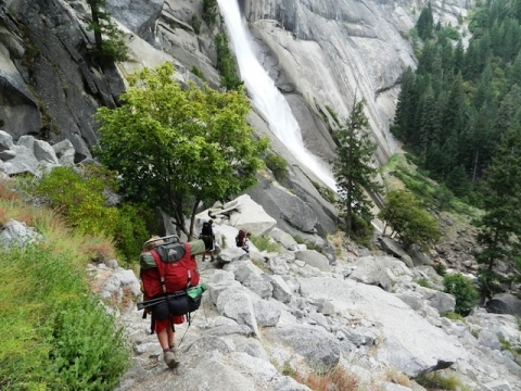 "Image of hiker going down a rocky ""Mist Trail\"""