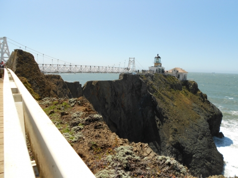 Bridge and lighthouse on cliff Point Bonita Lighthouse