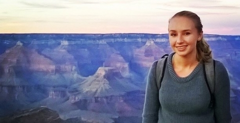 NPF staffer Marya stands against a backdrop of the Grand Canyon at dusk.