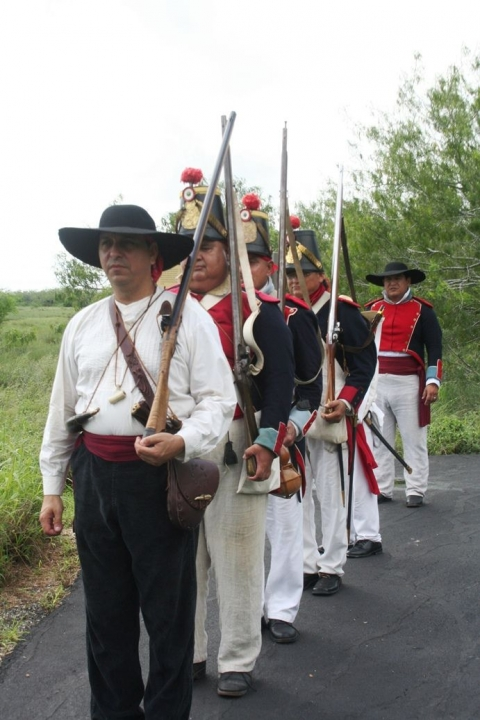 Uniformed living history performers line up in a row