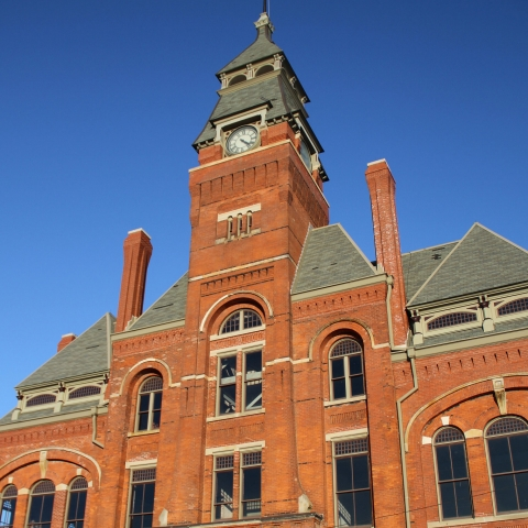 Red brick building with a tall clocktower
