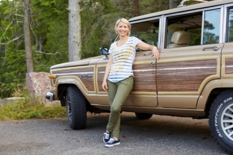 Photo of Sam Brown of the Travel Channel leaning against car