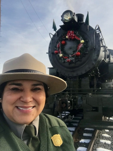 NPS Ranger Flor Blum with Baldwin Locomotive Works 26 at Steamtown National Historic Site