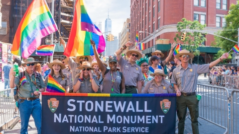 A group of National Park Service rangers celebrating the designation of Stonewall National Monument in New York