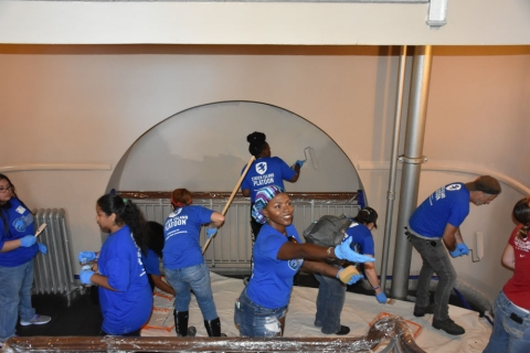 A group of veteran women from the Staten Island Platoon from The Mission Continues painting walls at Ellis Island