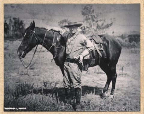 Roosevelt stands with his horse Manitou in the Badlands.