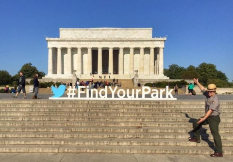 "Image of park ranger standing in front of Jefferson Memorial on a sunny day, with hashtag ""Find Your Park\"""