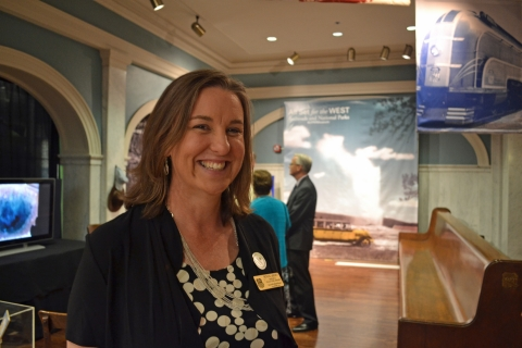 Curator Patricia LaBounty stands in the entrance of a new exhibit on railroads and the national parks