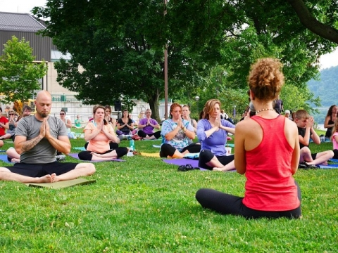 Participants practicing yoga at Wheeling National Heritage Site