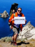 "Man holding sign that says, ""Discover\"""