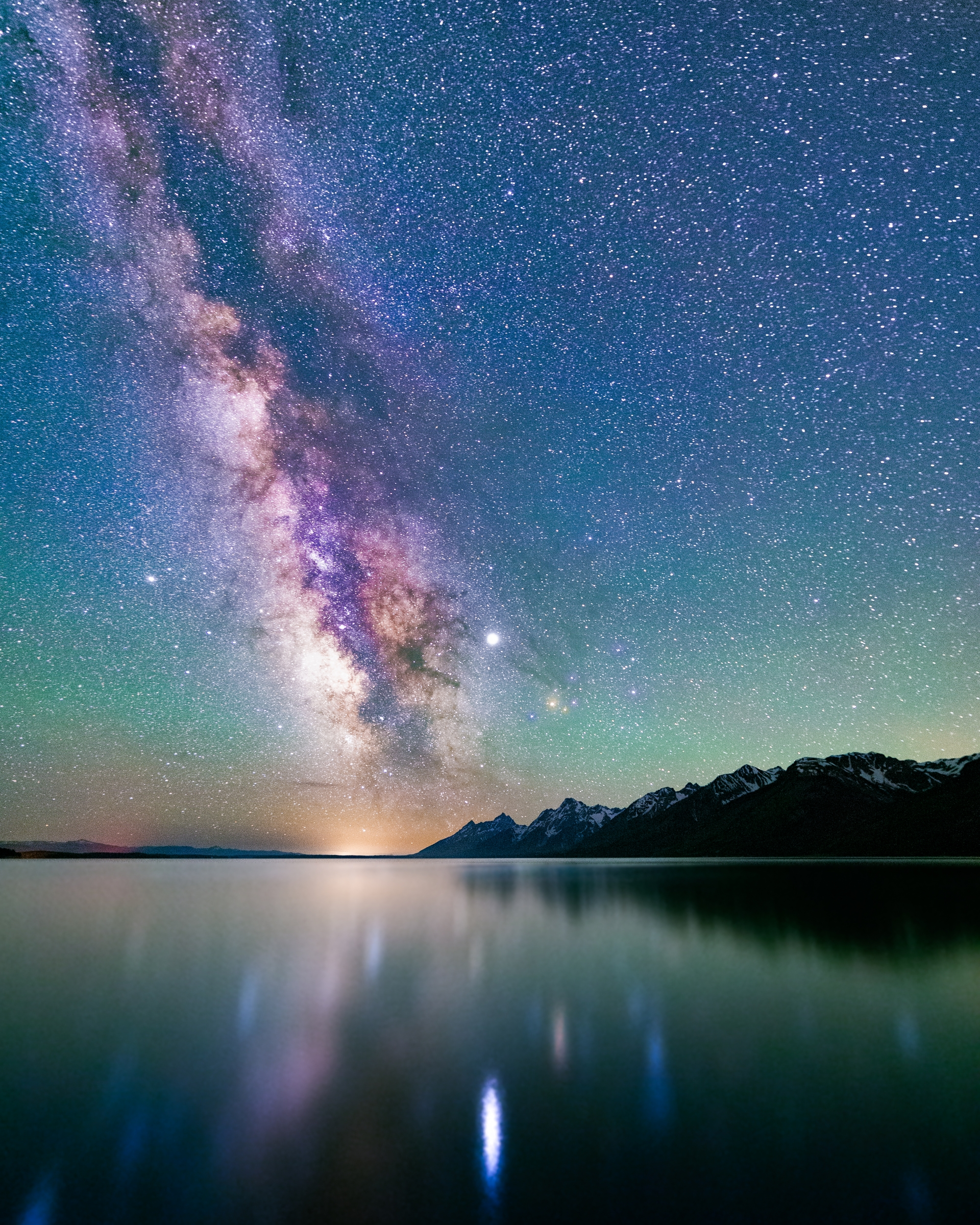 Starry skies over a lake in Grand Teton National Park